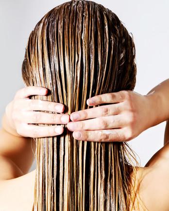 woman rinsing hair getty