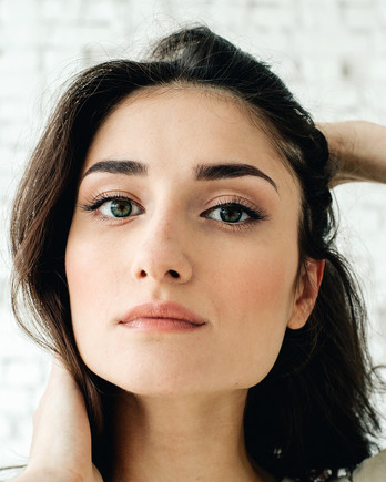 brunette woman with clear skin