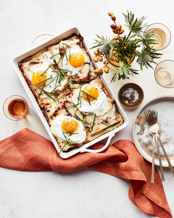 turkey-pastrami croque-madame casserole served in white dish