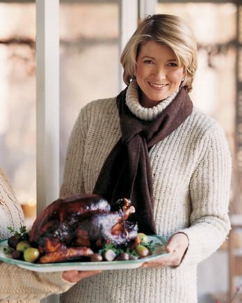 Martha Stewart holding Grilled Turkey Platter
