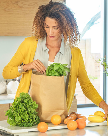woman-unloading-grocery-bag-0319