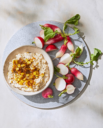 creamy corn-and-onion dip served with radishes
