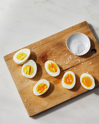 instant hard boiled eggs halved on wood cutting board