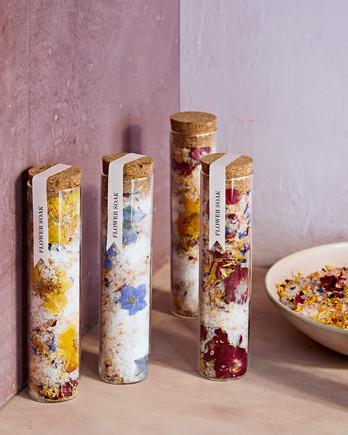 vials of homemade flower soak bath salts