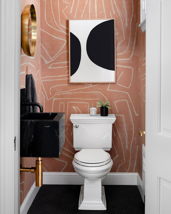 salmon and white geometric print bathroom walls