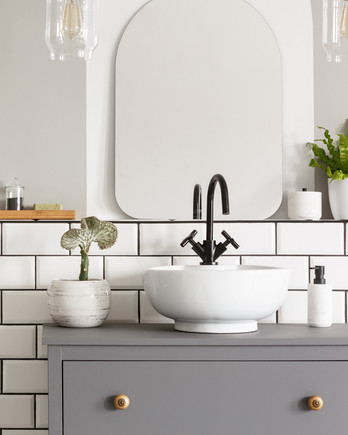 white bathroom with multiple plants