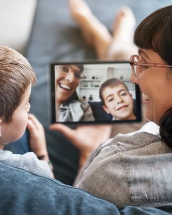 family hosting a virtual game night