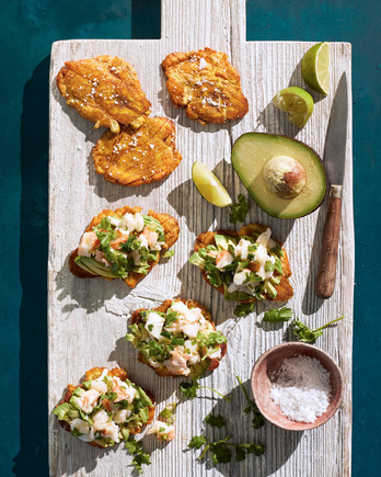 lobster salad with tostones served on a cutting board
