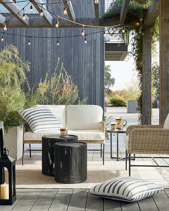 patio with wicker furniture and hanging string lights