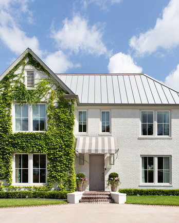 exterior shot of white houston home with ivy
