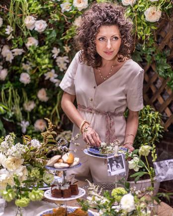 portrait of elisa marshall arranging plate at mothers day brunch