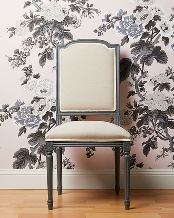 floral pink and gray wallpaper with chair