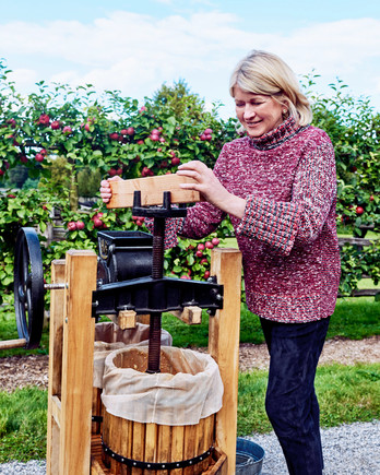 martha stewart pressing apples into a barrel