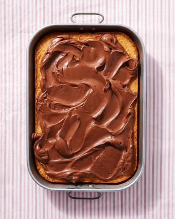 vanilla cake ganache frosting in pan