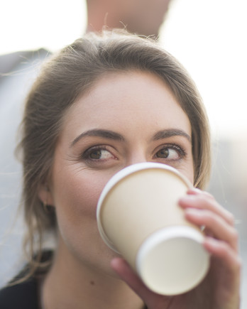 woman drinking to-go coffee