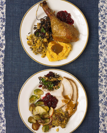 two plates of prepared thanksgiving meals