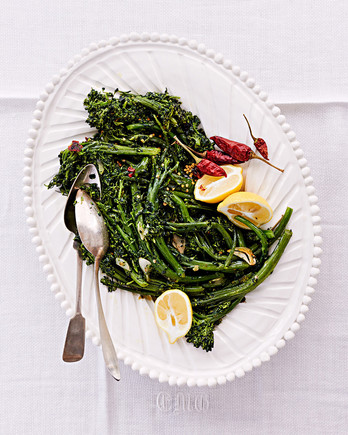 sprouting broccoli with peperoncini served with lemon wedges
