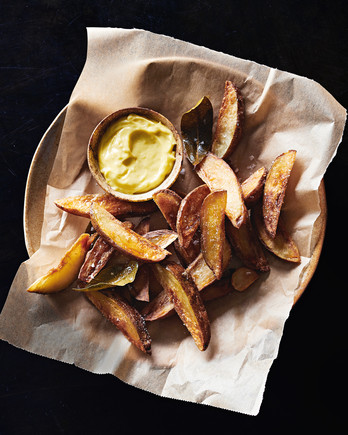 basket of olive-oil-fried potatoes with aioli