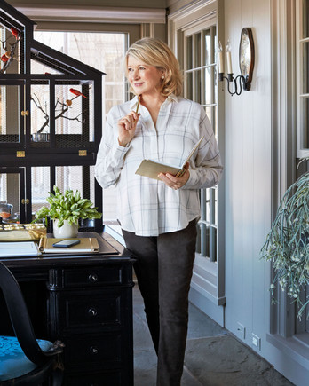 martha stewart with pen and notebook in office