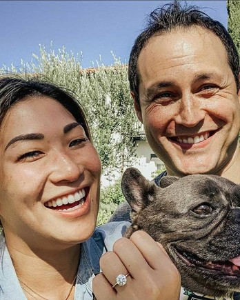 jenna ushkowitz and david stanley smiling in engagement photo with dog
