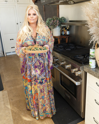 jessica simpson friendsgiving standing by stove