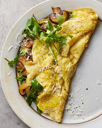 omelet with mushrooms avocado and watercress