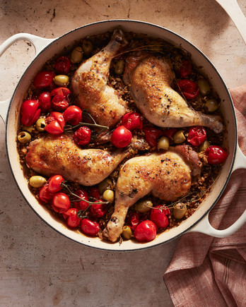 braised chicken with tomatoes and freekeh served in a casserole dish