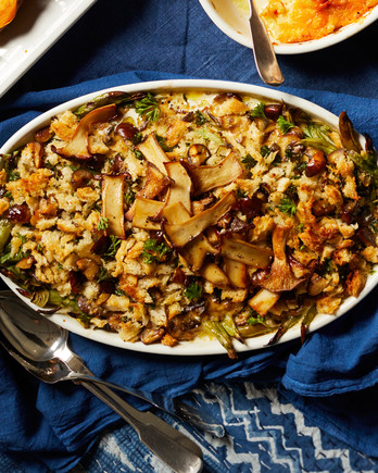 green-bean casserole with chestnuts and buttered breadcrumbs served in a white casserole dish