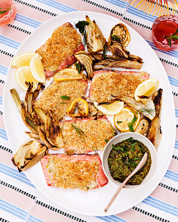 roasted wild salmon with caramelized fennel and fennel-frond pesto served with lemon wedges