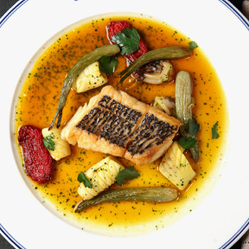 Thomas Keller's Mediterranean Bass with Squid, Fennel, and Tomatoes