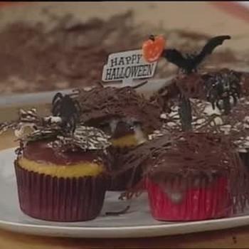 Pumpkin Muffins with Chocolate Spider Webs