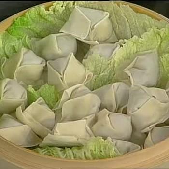 Emeril Lagasse Puts Together Pork Dumplings