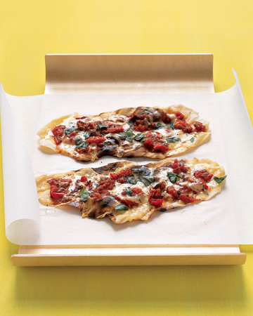 Grilled-Tomato Pizzettes With Basil and Fontina Cheese