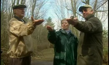 Hand-Feeding Walnut Pieces to Birds