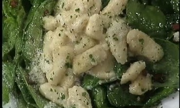 Hot Spinach Salad Topped with Gnocchi