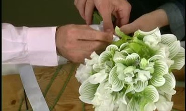 A Sweet Pea Wedding Bouquet and Boutounieres
