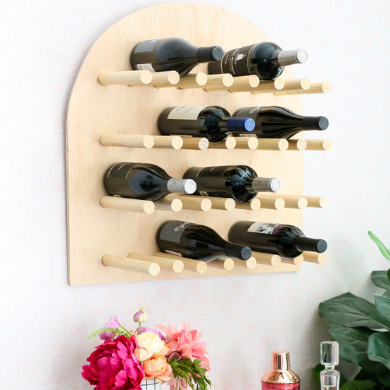 birch plywood wine rack hanging above bar cart