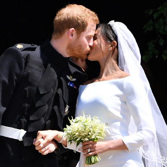 Meghan Markle and Prince Harry kiss on their wedding day.