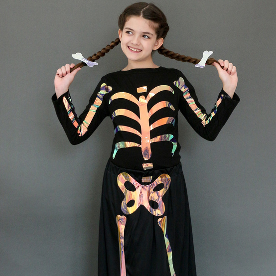 child posing in iridescent skeleton costume