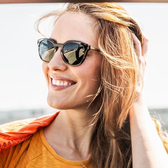 woman wearing sunglasses under the sun