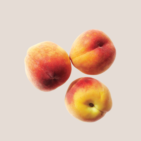 three peaches on tan background