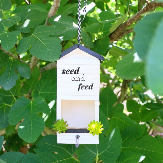 milk carton upcycled into a bird feeder