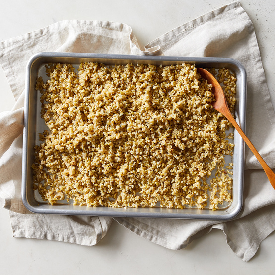 freekeh in pan with spoon
