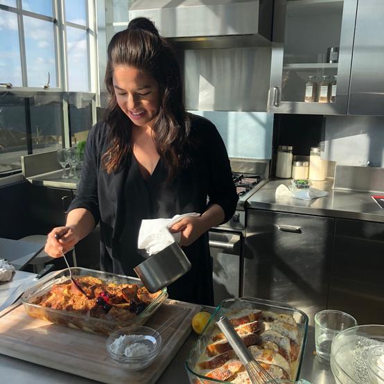 test kitchen women adding blueberry mix to french toast dessert