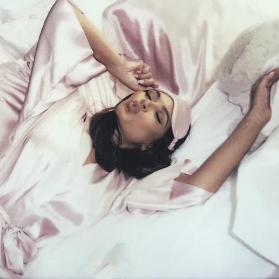 Woman in Bed Wearing Silk Eye Mask