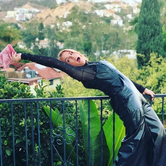 Busy Philipps on a balcony