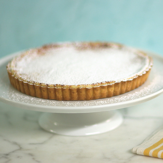 lemon curd souffle tart topped with powdered sugar