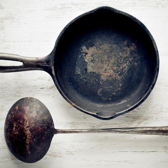 antique cast iron pan rusty