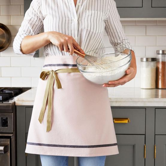 woman whisking wearing diy apron