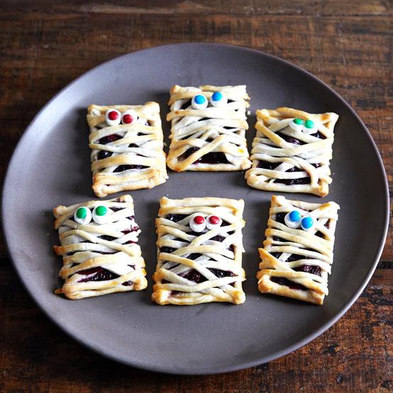 mummy hand pie pastries on gray plate